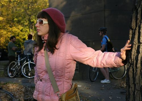 11 Pink coat and white sunglasses